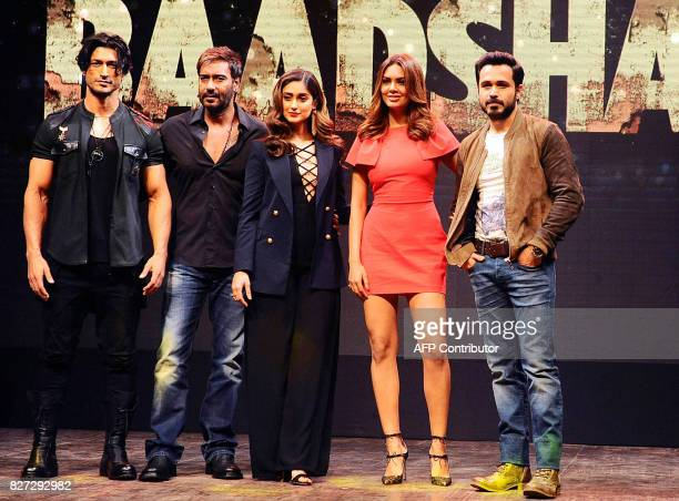 Indian Bollywood actors Vidyut Jamwal Ajay Devgn Ileana D'Cruz Esha Gupta and Emraan Hashmi pose for a photograph during a promotional event for the...