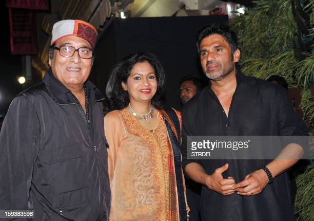 Indian Bollywood actors Vinod Khanna with wife Kavita and Sunil Shetty during the inauguration of a furniture showroom by actors Sunil and Mana...
