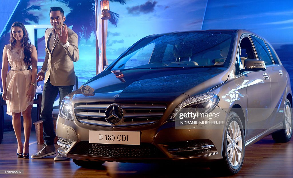 Indian Bollywood actress Aditi Rao Hydari (L) and actor Abhay Deol pose during a news conference at the launch of the new Mercedes-Benz B Class 180 CDI in Mumbai on July 11, 2013.