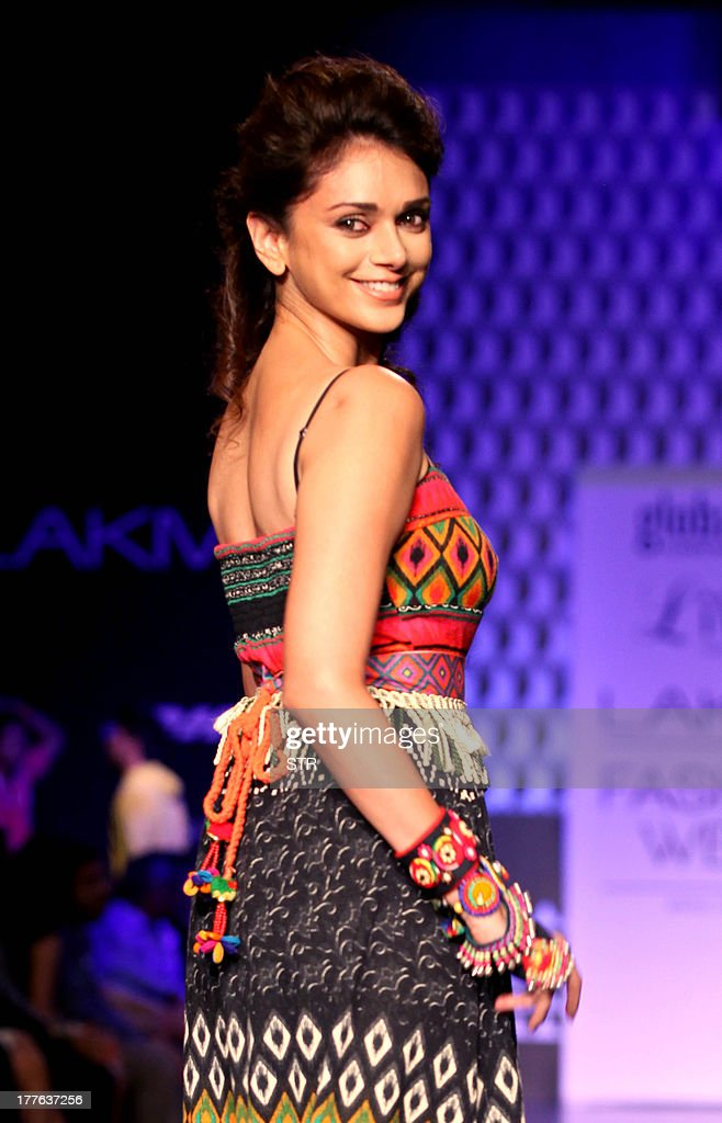 Indian Bollywood actress Aditi Rao Hydari showcases a creation by designer Anita Dongare during the Lakme Fashion Week (LFW) Winter/Festival 2013 in Mumbai on August 25, 2013.