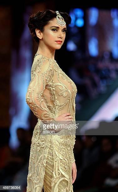 Indian Bollywood actress Aditi Rao Hydari showcases a creation by designer Neeta Lulla during the Blenders Pride Fashion Tour 2014 in Mumbai on...