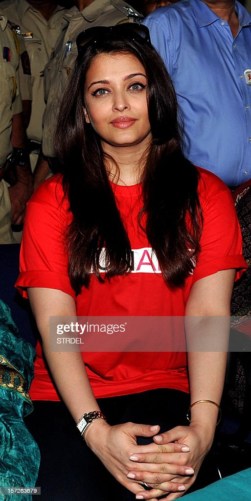 Indian Bollywood actress Aishwarya Rai Bachchan looks on while visiting the Lokmanya Tilak municipal medical general hospital to meet children suffering from AIDS in Mumbai on December 1, 2012. AFP PHOTO /STR
