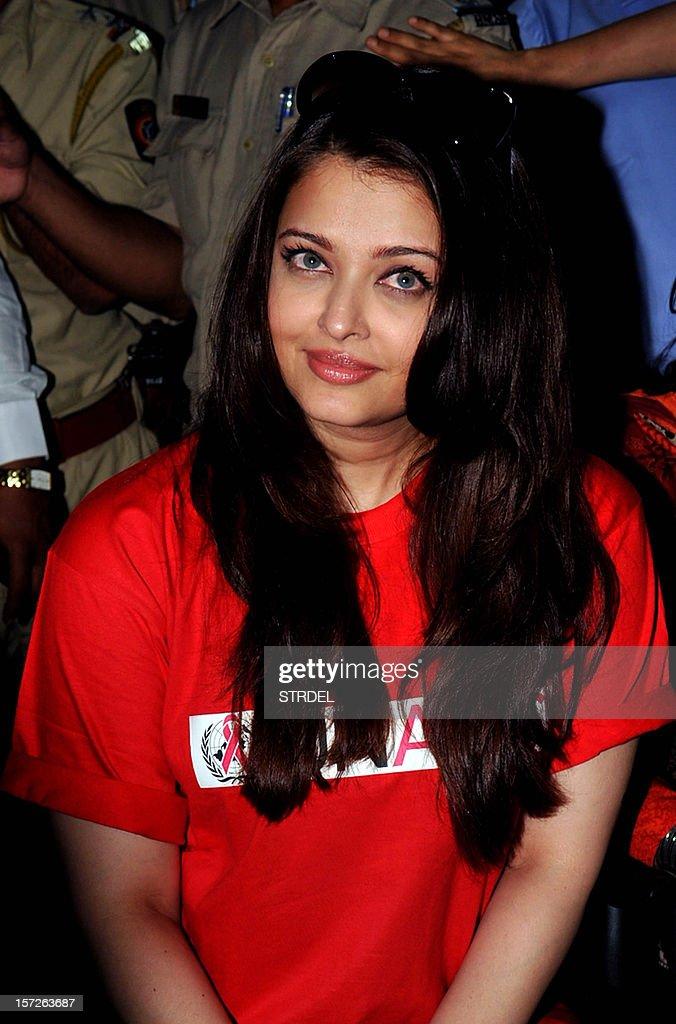 Indian Bollywood actress Aishwarya Rai Bachchan looks on while visiting the Lokmanya Tilak municipal medical general hospital to meet children suffering from AIDS in Mumbai on December 1, 2012.