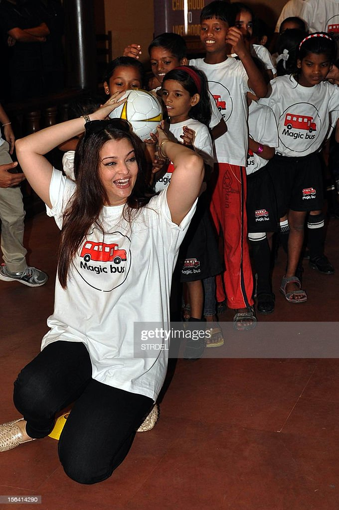 Indian Bollywood actress Aishwarya Rai Bachchan plays with a group of children on the occasion of Children's Day in Mumbai late November 14, 2012.