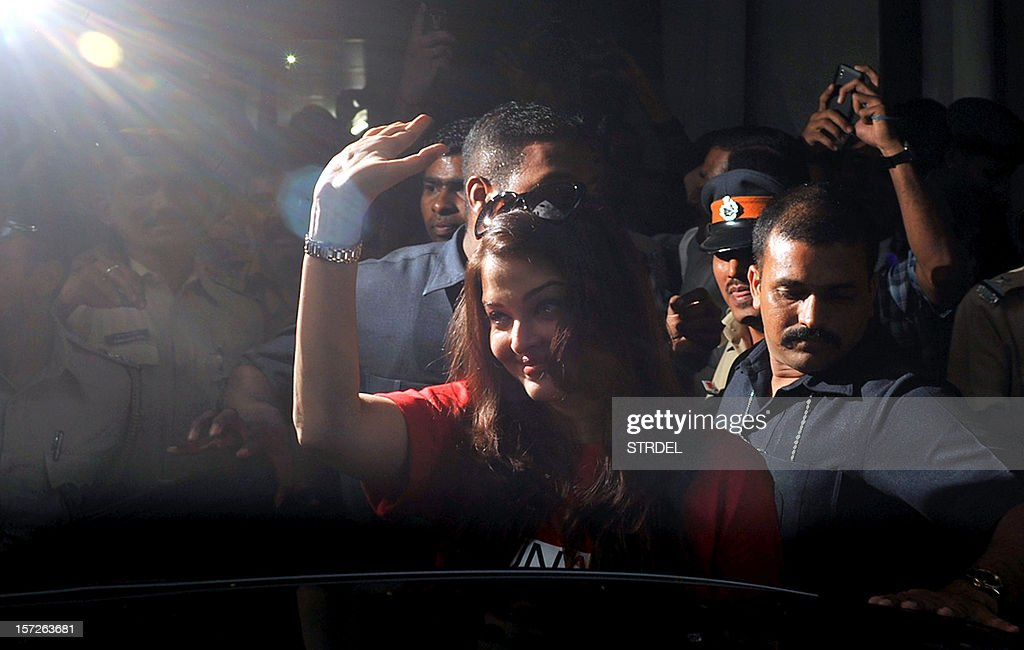 Indian Bollywood actress Aishwarya Rai Bachchan waves before visiting the Lokmanya Tilak municipal medical general hospital to meet children suffering from AIDS in Mumbai on December 1, 2012.