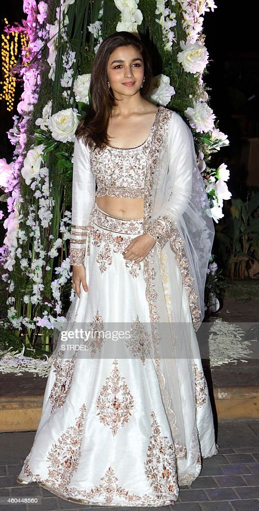 Indian Bollywood actress <a gi-track='captionPersonalityLinkClicked' href=/galleries/search?phrase=Alia+Bhatt&family=editorial&specificpeople=9620703 ng-click='$event.stopPropagation()'>Alia Bhatt</a> attends the marriage Sangeet ceremony of Bollywood film director Punit Malhotra and Riddhi Malhotra, the sister of designer Manish Malhotra, in Mumbai on December 13, 2014.