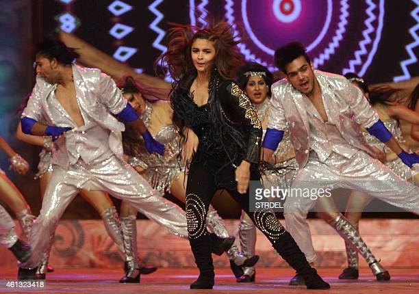Indian Bollywood actress Alia Bhatt dances during the annual 'Umang 2015 Mumbai Police Show' in Mumbai on late January 10 2015 AFP PHOTO / STR