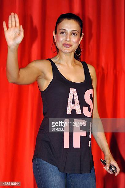 Indian Bollywood actress Ameesha Patel poses for a photograph during a promotional event for the forthcoming Hindi film 'Ekkees Toppon Ki Salaami'...
