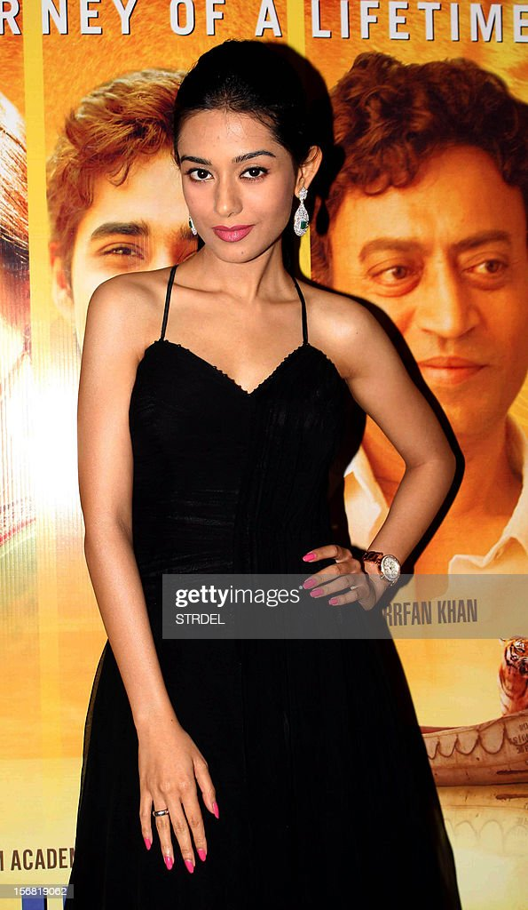 Indian Bollywood actress Amrita Rao poses as she attends a special screening of the film 'Life of Pi' in Mumbai late November 21, 2012.
