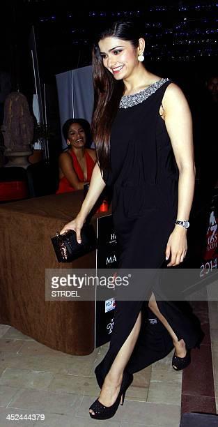 Indian Bollywood actress and competition judge Prachi Desai walks past Bollywood actress and competition judge Priyanka Bose during the KamaSutra...