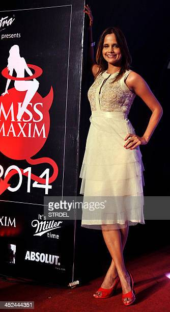 Indian Bollywood actress and model Nisha Harale poses for a photograph during the KamaSutra Miss Maxim 2014 competition final in Mumbai on November...