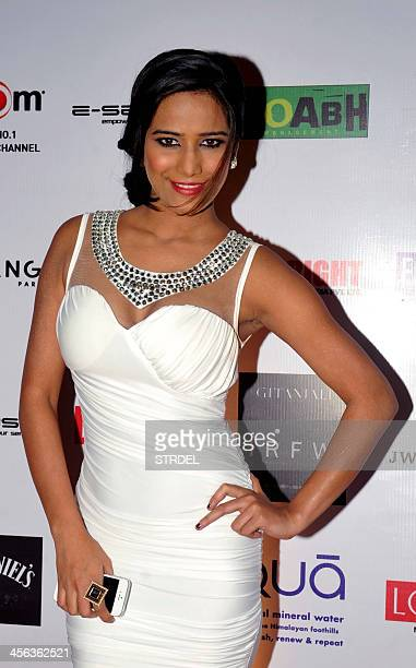 Indian Bollywood actress and model Poonam Pandey poses for a photograph during the India Resort Wear Fashion Week in Mumbai on December 13 2013 AFP...