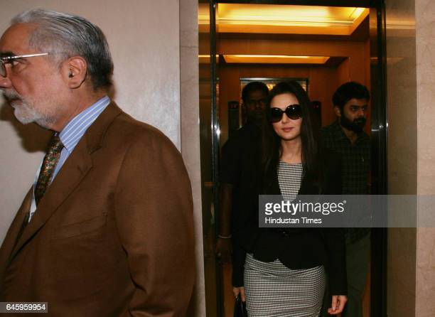 Indian Bollywood actress and owner of Kings XI Punjab IPL cricket team Preity Zinta arrives to attend the Indian Premier League auction in Mumbai on...