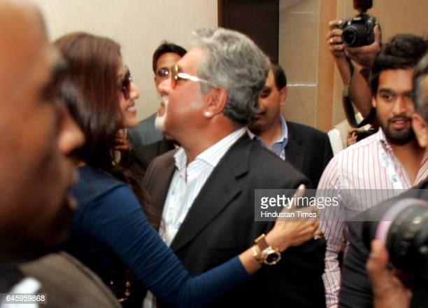Indian Bollywood actress and owner of Rajasthan Royals IPL cricket team Shilpa Shetty greets Vijay Mallya owner of Royal Challengers Bangalore as...