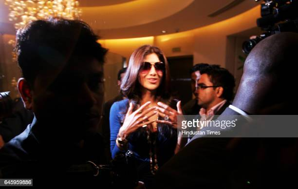 Indian Bollywood actress and owner of Rajasthan Royals IPL cricket team Shilpa Shetty arrives to attend the Indian Premier League auction in Mumbai...