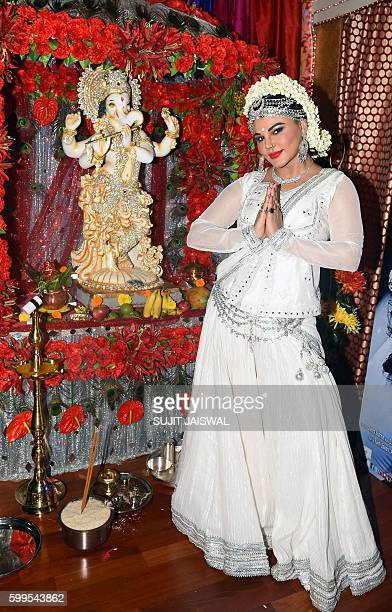 Indian Bollywood actress and politician Rakhi Sawant poses alongside a statue of the elephantheaded Hindu god Lord Ganesh to mark the Hindu festival...
