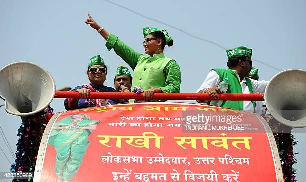 Indian Bollywood actress and Rashtriya Aam Party candidate Rakhi Sawant campaigns during a roadshow in Mumbai on April 8 2014 Indians began voting...