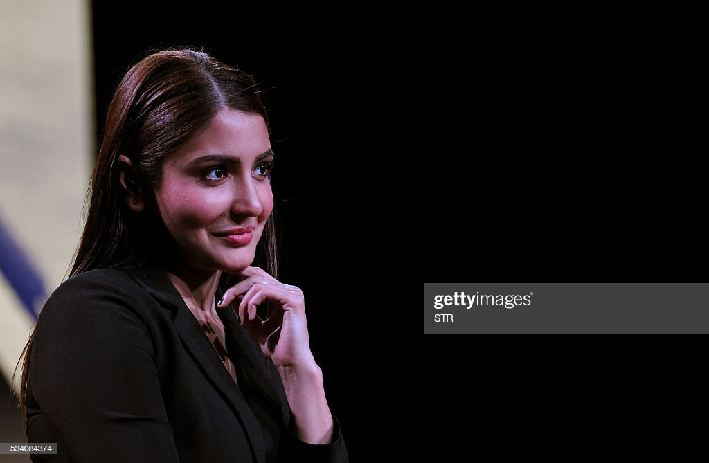 Indian Bollywood actress Anushka Sharma looks on during a promotional event for the forthcoming Hindi film 'Sultan' directed by Ali Abbas Zafar in Mumbai on late May 24, 2016. / AFP / STR