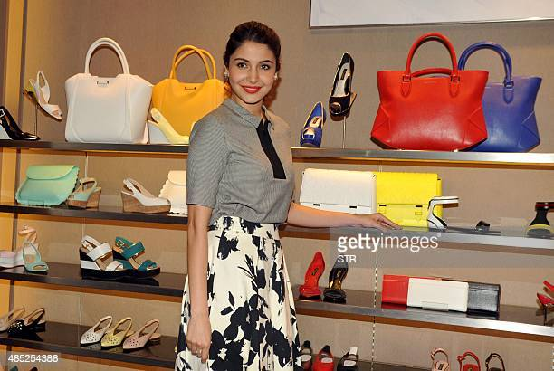 Indian Bollywood actress Anushka Sharma poses during the launch of the Charles and Keith Spring Summer 2015 collection and also promotes upcoming...