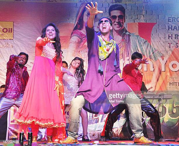 Indian Bollywood actress Asin Thottumkal and actor Akshay Kumar dance during a promotional event for the forthcoming Hindi film Khiladi 786 in Mumbai...
