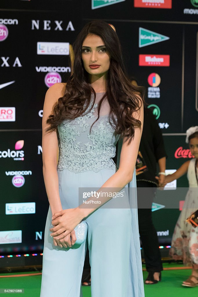 Indian Bollywood actress Athisa Shetty poses on the green carpet as she arrives to the 17th edition of IIFA Awards (International Indian Film Academy Awards) in Madrid on June 24, 2016.