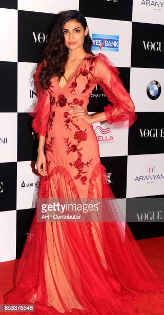 Indian Bollywood actress Athiya Shetty poses for a photo during the 10th edition of the 'Vogue Women of the Year Awards' event in Mumbai on September...