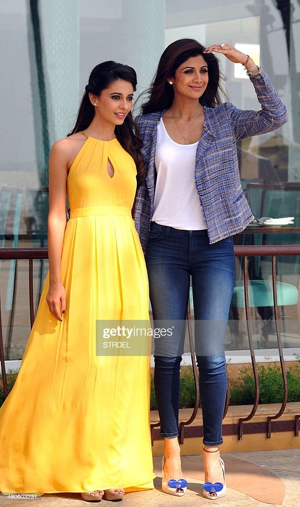Indian Bollywood actress Ayesha Khanna (L) and producer Shilpa Shetty pose for a photograph during a promotional event for the forthcoming Bollywood film 'Dishkiyaaoon' produced by Shilpa Shetty and directed by Sanamjit Singh Talwar in Mumbai on March 25, 2014.