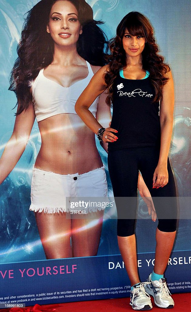 Indian Bollywood actress Bipasha Basu poses during the launch of her fitness DVD 'Break Free' in Mumbai on January 4, 2013. AFP PHOTO/STR