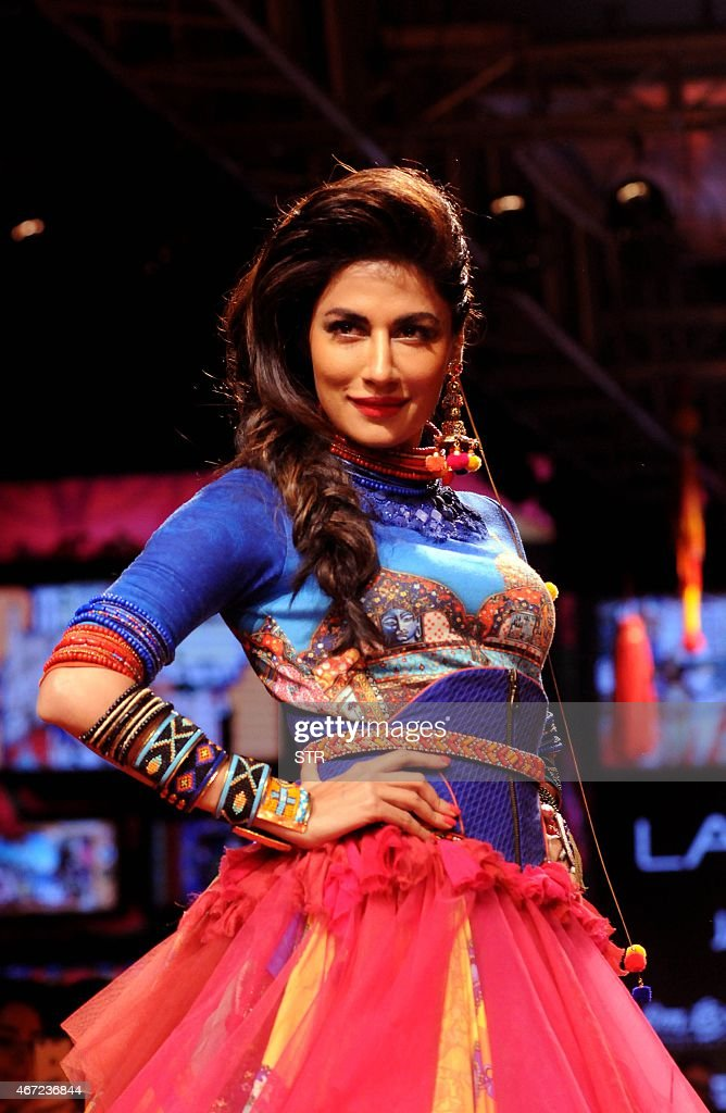 Indian Bollywood actress Chitrangada Singh showcases a creation by designer Tarun Tahiliani on the fifth day of the Lakme Fashion Week (LFW) summer/resort 2015 in Mumbai on March 22, 2015.