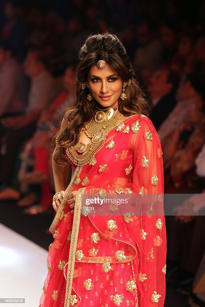 Indian Bollywood actress Chitrangada Singh showcases a creation during India International Jewellery Week 2015 in Mumbai on August 3, 2015.