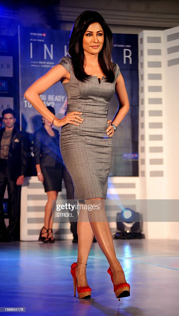 Indian Bollywood actress Chitrangda Singh (C) walks the ramp during a promotional event in Mumbai on January 3, 2013. AFP PHOTO/STR