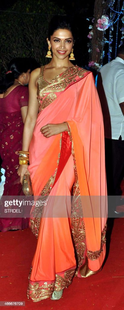 Indian Bollywood actress Deepika Padukone poses as she attends the wedding reception of actress Ahana Deol and husband Vaibhav Vohra in Mumbai on February 2, 2014.