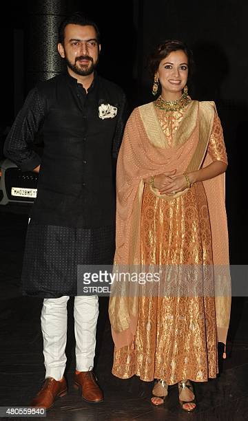 Indian Bollywood actress Dia Mirza and her husband producer Sahil Sangha arrive for the wedding reception of Bollywood actor Shahid Kapoor in Mumbai...