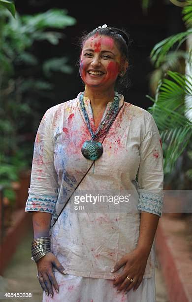 Indian Bollywood actress Divya Dutta celebrates Holi the 'festival of colours' in Mumbai on March 6 2015 AFP PHOTO