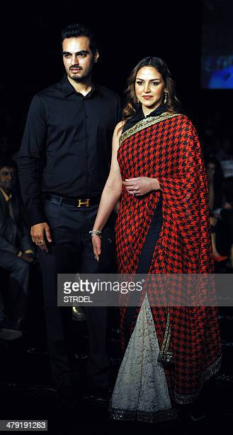 Indian Bollywood actress Esha Deol and her husband Bharat Takhtani pose as they arrive to attend The Grand Finale of Lakme Fashion Week summer/resort...