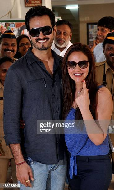 Indian Bollywood actress Esha Deol and her husband Bharat Takhtani pose for a photograph after voting at a polling station in Mumbai on April 24 2014...