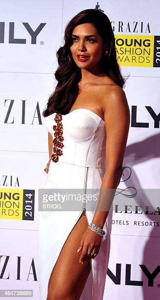 Indian Bollywood actress Esha Gupta poses for a photograph during the Grazia Young Fashion Awards 2014 ceremony in Mumbai on late April 13 2014 AFP...