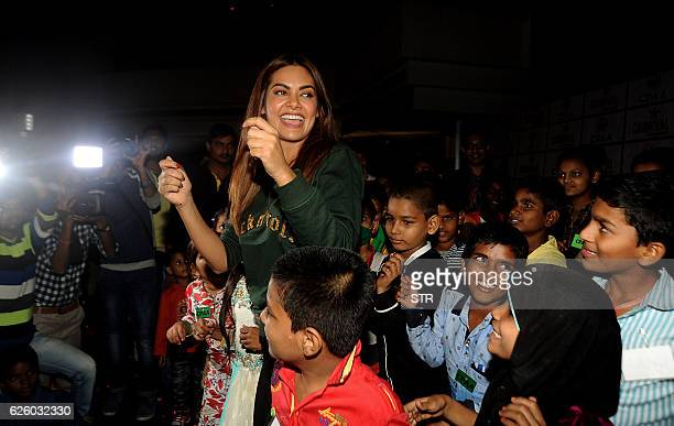 Indian Bollywood actress Esha Gupta takes part in a promotional event in Mumbai on November 26 2016 / AFP / STR