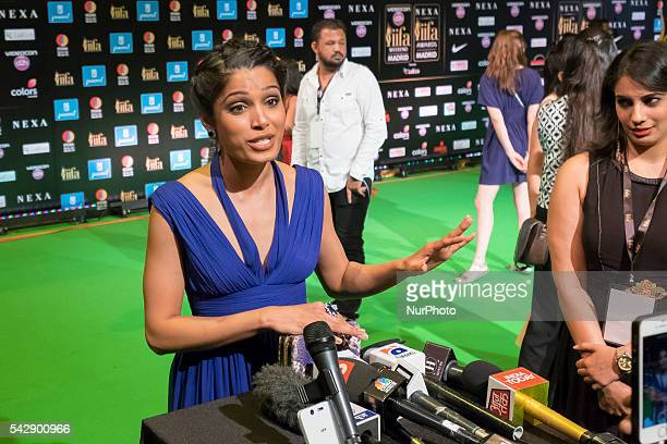 Indian Bollywood actress Freida Pinto poses on the green carpet as she arrives to the 17th edition of IIFA Awards in Madrid on June 24 2016