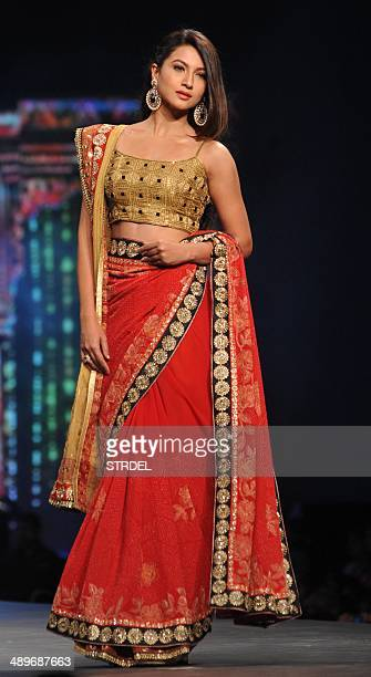 Indian Bollywood actress Gauhar Khan displays a creation by designer Shaina NC during a cancer fundraiser in Mumbai on May 11 2014 AFP PHOTO/STR