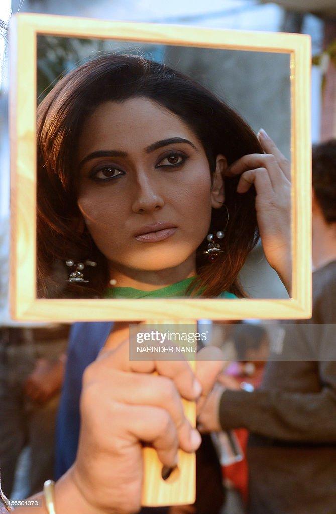 ... Indian Bollywood actress <b>Gauri Singh</b> is reflected in a mirror as she ... - indian-bollywood-actress-gauri-singh-is-reflected-in-a-mirror-as-she-picture-id156504373