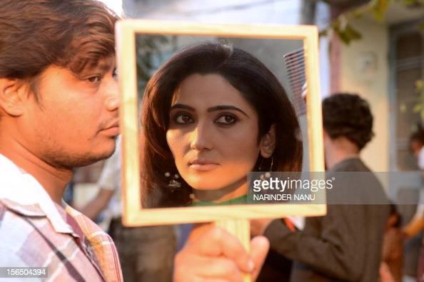... Indian Bollywood actress <b>Gauri Singh</b> is reflected in a mirror as she ... - indian-bollywood-actress-gauri-singh-is-reflected-in-a-mirror-as-she-picture-id156504394?s=594x594