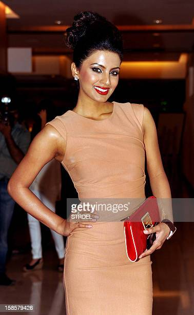 Indian Bollywood actress Geeta Basara poses as she attends the unveiling of a new Playboy bunny costume ahead of it's forthcoming Indian club launch...