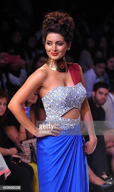 Indian Bollywood actress Geeta Basra showcases a creation by designer Sougat Paul during the Lakme Fashion Week Winter/Festival 2014 in Mumbai on...