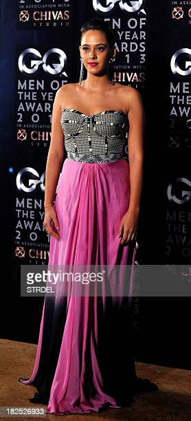 Indian Bollywood actress Hazel Keech poses as she attends the GQ India fifth anniversary 'Men of the Year' Awards ceremony in Mumbai late September...