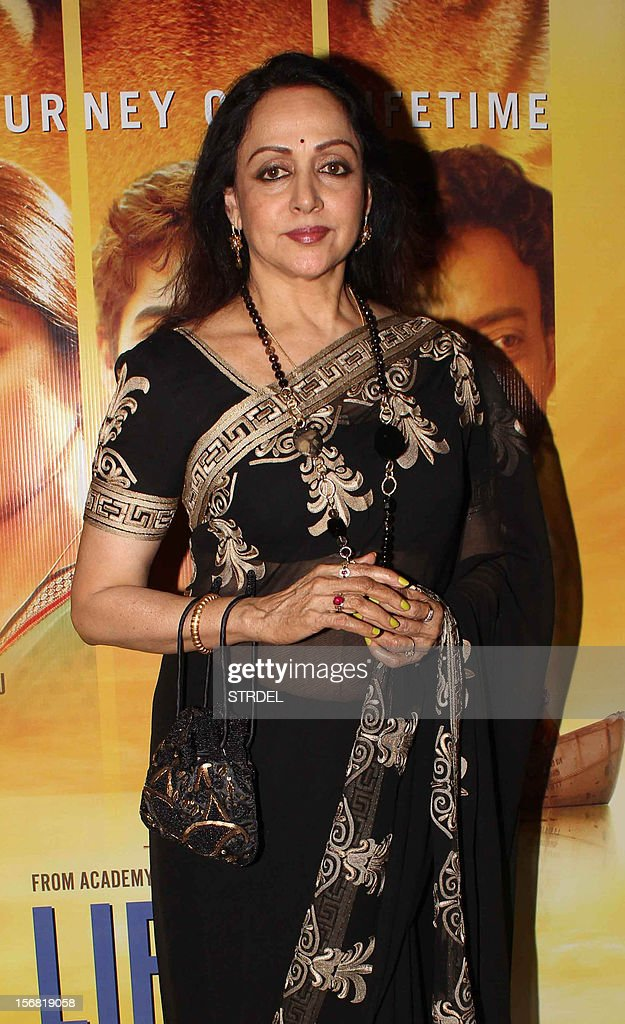 Indian Bollywood actress Hema Malini poses as she attends a special screening of the film 'Life of Pi' in Mumbai late November 21, 2012. AFP PHOTO/STR
