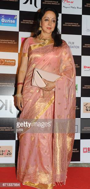 Indian Bollywood actress Hema Malini poses as she attends the Dadasaheb Phalke Excellence Awards Ceremony 2017 in Mumbai late April 22 2017 / AFP...