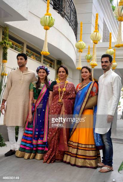 Indian Bollywood actress Hema Malini poses for a photograph alongside daughter and actress Esha Deol soninlaw Bharat Takhtani Bollywood actress Ahana...