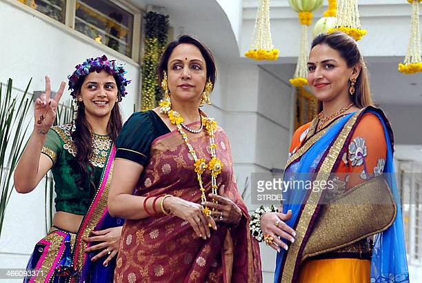 Indian Bollywood actress Hema Malini poses for a photograph alongside daughters the actress Esha DeolTakhtani Bollywood actress Ahana Deol during...