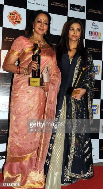 Indian Bollywood actress Hema Malini poses with Aishwarya Rai Bachchan as they attend the Dadasaheb Phalke Excellence Awards Ceremony 2017 in Mumbai...